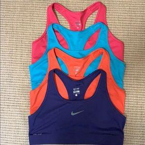 4 Nike Pro Dri-Fit Sports Bras (Large)